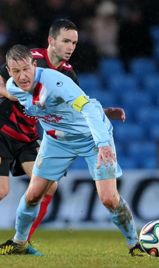 Ballymena United captain Allan Jenkins holds off the challenge of Bannsiders midfielder Neil McCafferty in the Warden Street clash
