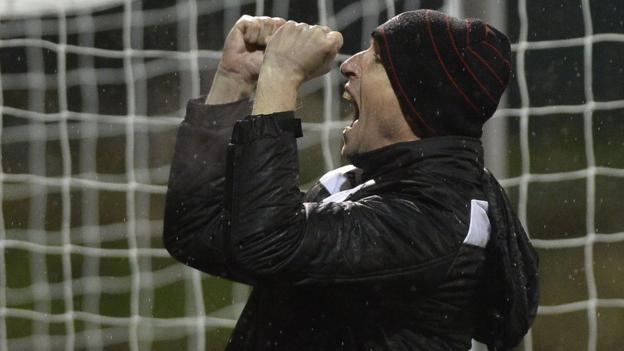 Crusaders manager Stephen Baxter shows his delight after the 1-0 win over champions Cliftonville