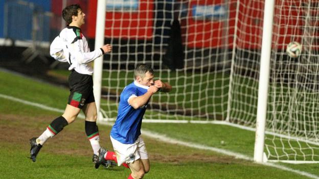 Ivan Sproule nets the winner for Linfield in the 2-1 win over Glentoran but he was sent-off seconds later when he picked up a second yellow for taking his shirt off in celebration