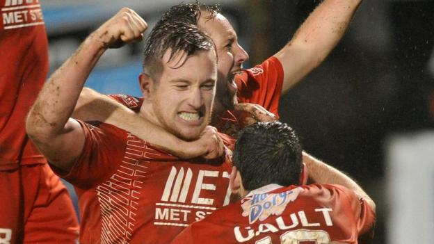 Mark McAllister celebrates with his Portadown team-mates after making it 3-2 against Glenavon at Shamrock Park