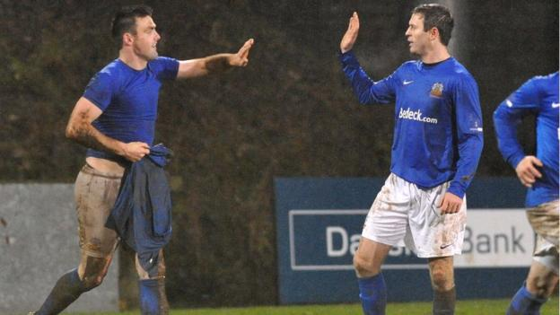 Eoin Bradley is congratulated by Glenavon strike partner Kevin Braniff and his late penalty secured a 3-3 draw with Portadown