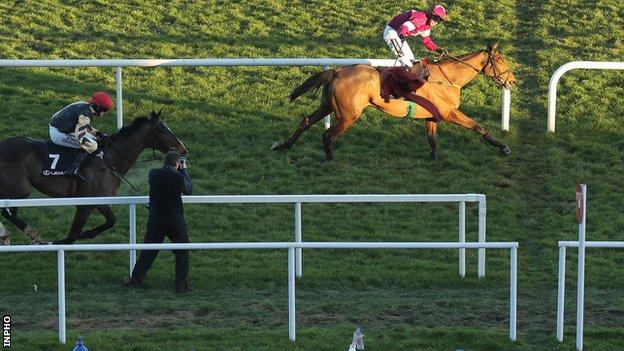 Road To Riches crosses the finishing line ahead of On His Own in the Lexus Chase