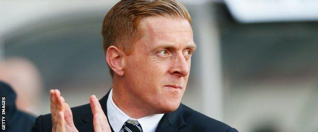 Garry Monk manager of Swansea City looks on prior to the Barclays Premier League match between Swansea City and Crystal Palace at Liberty Stadium on November 29, 2014.