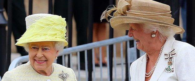 Queen Elizabeth shares a laugh with Dame Mary Peters during a visit to Belfast in June