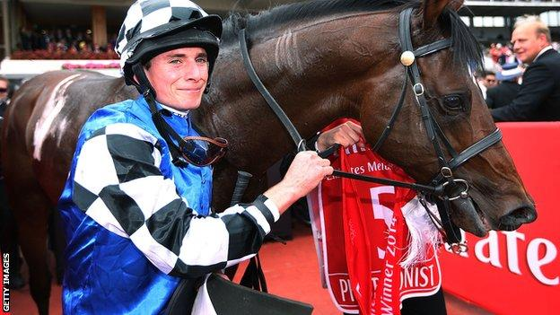 Jockey Ryan Moore celebrates after winning on Protectionist in race 7 the Emirates Melbourne Cup on Melbourne Cup Day at Flemington Racecourse on November 4, 2014
