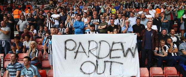 Newcastle United fans hold a 'Pardew Out' banner during the Barclays Premier League match between Southampton and Newcastle United at St Mary's