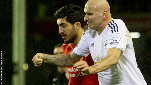 Jonjo Shelvey (R) of Swansea clashes with Emre Can (L) of Liverpool