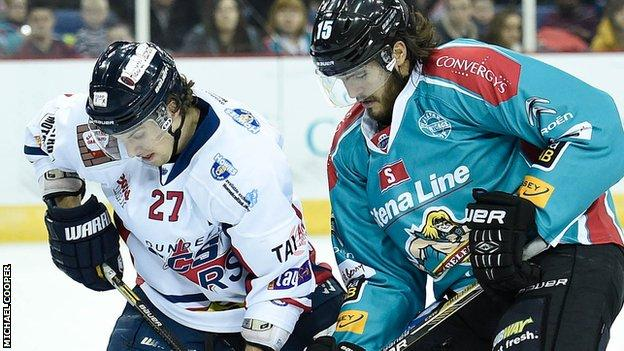 Kevin Westgarth of the Belfast Giants in action against Kevin Quick of the Dundee Stars