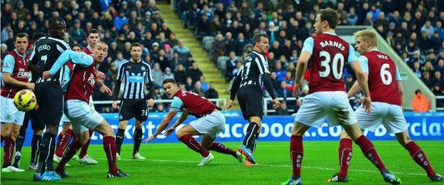 Steven Taylor scores Newcastle's opening goal against Burnley