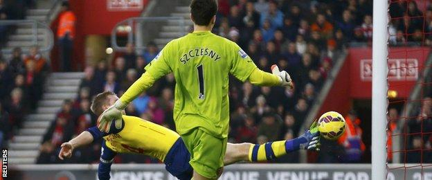 Per Mertesacker lunged but could not keep out Sadio Mane's curled effort as Szczesny raced back