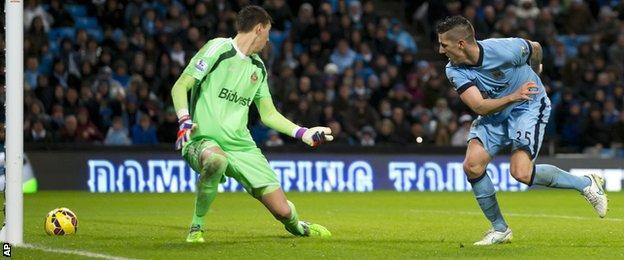 Manchester City forward Stevan Jovetic scores against Sunderland