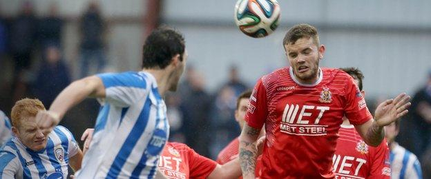 Darren Murray sends a header towards the Coleraine goal in a tight Showgrounds encounter