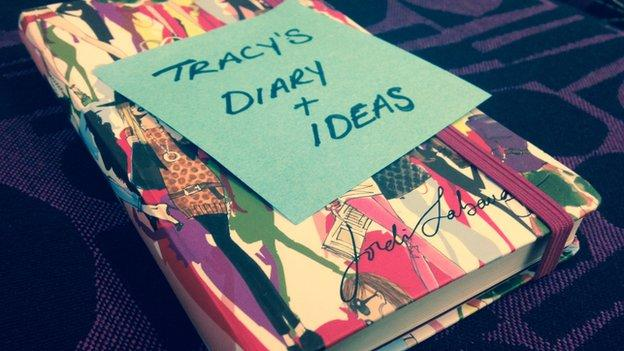 a notebook with Tracy's diary written on a post-it note