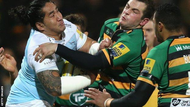 Anitelea Tuilagi of Newcastle (l) is stopped by Stephen Myler