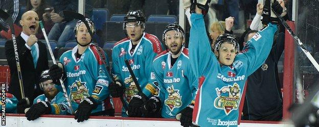 The Giants bench celebrates after watching their side score one of their six goals against Sheffield on Saturday night