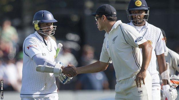Sri Lanka batsman Kumar Sangakkara is congratulated by New Zealand's Ross Taylor following his dismissal for 203