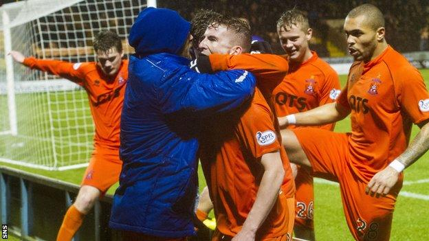 Craig Slater is surrounded by celebrating Kilmarnock team-mates