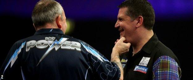 Phil Taylor jokes with Gary Anderson