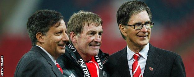 John Henry (right) with Liverpool legend Kenny Dalglish (centre)