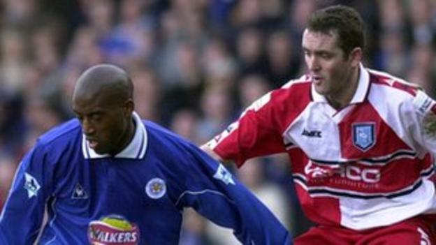 Dean Sturridge of Leicester holds off Paul McCarthy of Wycombe in the quarter-final