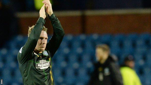 Kris Commons applauds the Celtic fans at Rugby Park