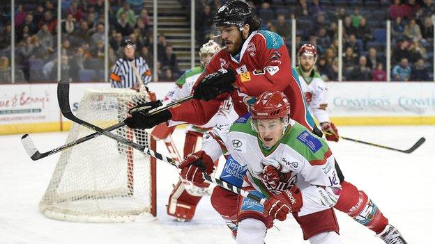 Belfast's Kevin Westgarth makes a high challenge on Devils opponent Mark Richardson
