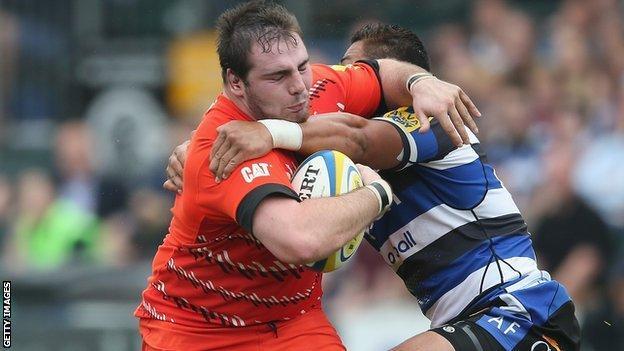 Fraser Balmain (left) is tackled by Bath's Alafoti Fa'osiliva
