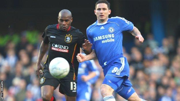 Huddersfield's Frank Sinclair comes up against Frank Lampard of Chelsea in an FA Cup tie in 2008