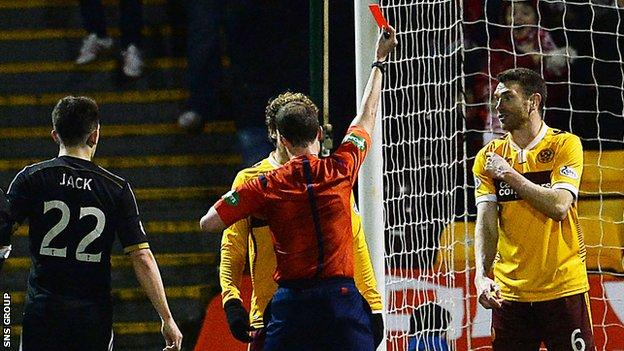 Motherwell's Stephen McManus protests his innocence to referee Willie Collum