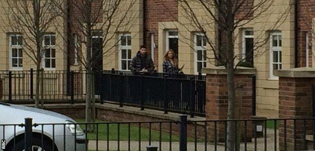 Ched Evans leaves his Cheshire home with girlfriend Natasha Massey