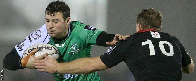 Robbie Henshaw tries to hand off Greig Tonks in Galway