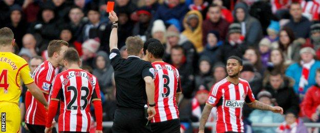 Sunderland midfielder Liam Bridcutt (right) is sent off for his second booking against Liverpool