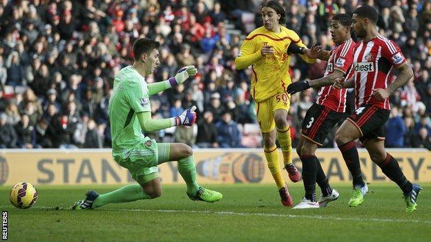 Liverpool wing-back Lazar Markovic (centre) scores for his side at Sunderland