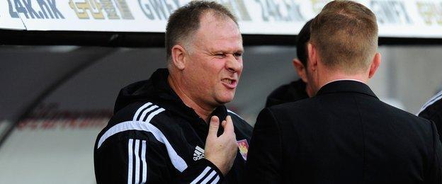 West Ham assistant manager Neil McDonald meets Swansea's Garry Monk