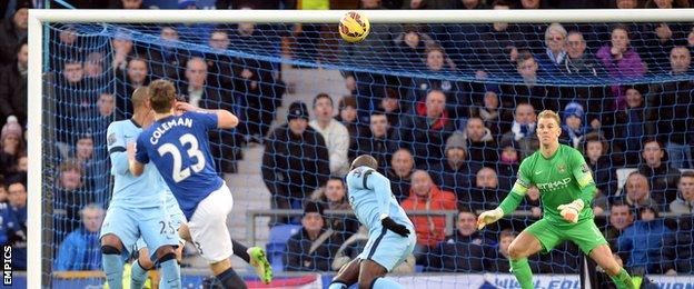 Everton defender Seamus Coleman watches as his shot hits the Manchester city crossbar