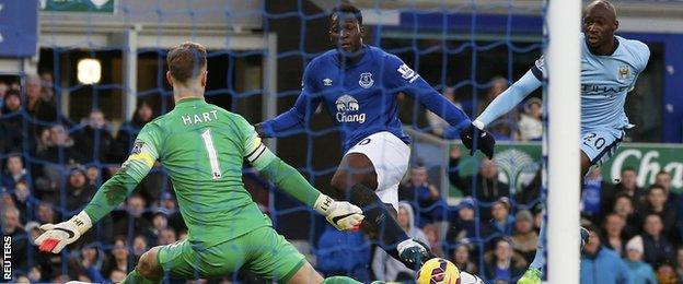 Everton striker Romelu Lukaku (centre) has a shot saved by Man City keeper Joe Hart