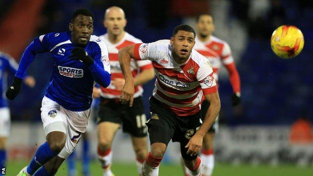 Oldham's Amari Morgan-Smith and Doncaster's Kyle Bennett