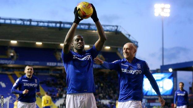 Clayton Donaldson celebrates his hat-trick against Wigan