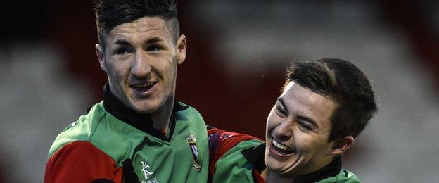 Danny McKee celebrates with Glentoran team-mate Jordan Stewart after scoring the first goal against Ards