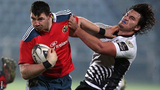 Munster's Paddy Butler with a hand-off on Zebre opponent Jacopo Sarto