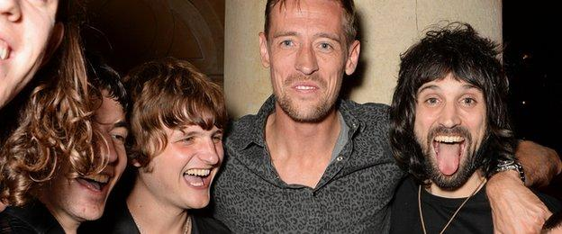 Jeff Wootton, Jay Sharrock, Peter Crouch and Sergio Pizzorno after the Kasabian gig