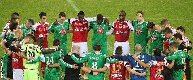 Reims and St Etienne players stood in a circle as they observed a minute of silence in tribute to the victims