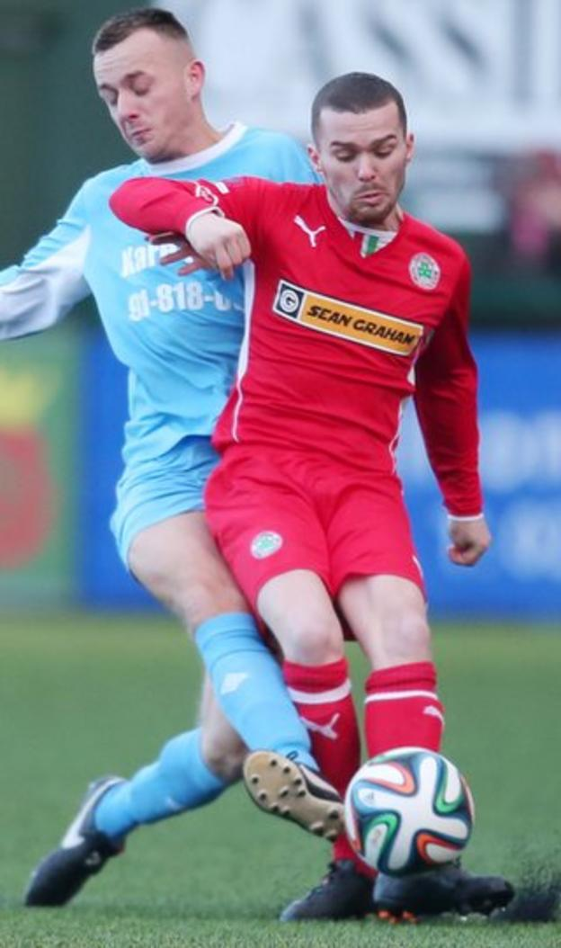 Ryan Newberry of Ards Rangers puts a tackle in on Cliftonville winger Martin Donnelly at Solitude
