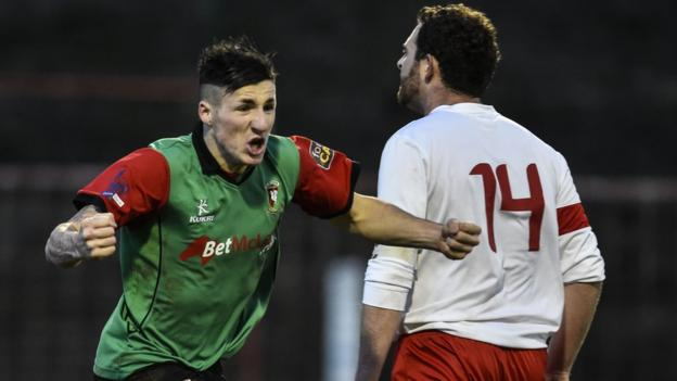 Danny McKee makes the breakthrough for Glentoran in a 2-0 victory over Ards in east Belfast