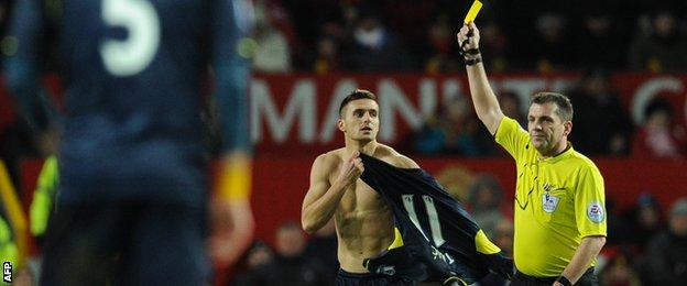 Dusan Tadic was booked for taking off his shirt during his goal celebration