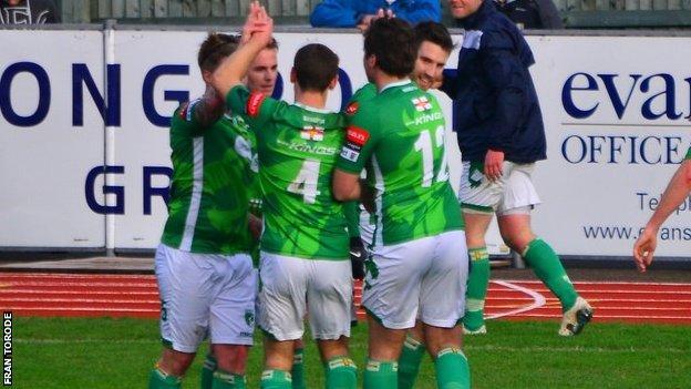 Guernsey FC celebrate their third goal against Corinthian Casuals