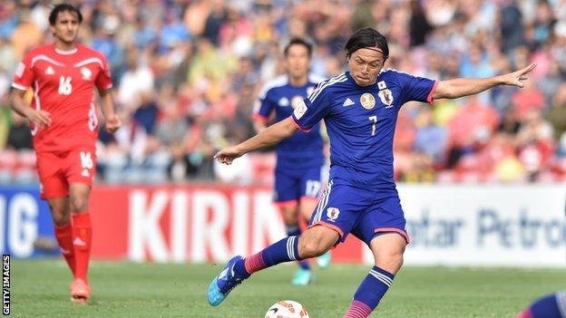 Yasuhito Endo scores a goal for Japan against Palestine