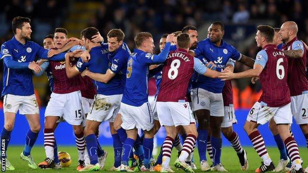 Leicester and Aston Villa players clash during the game between their sides