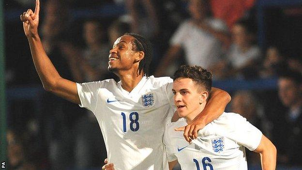Kwame Thomas (left) celebrates scoring for England Under-20 against Romania in September