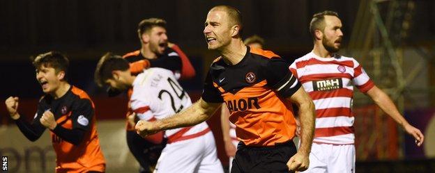 Sean Dillon celebrates scoring United's winner